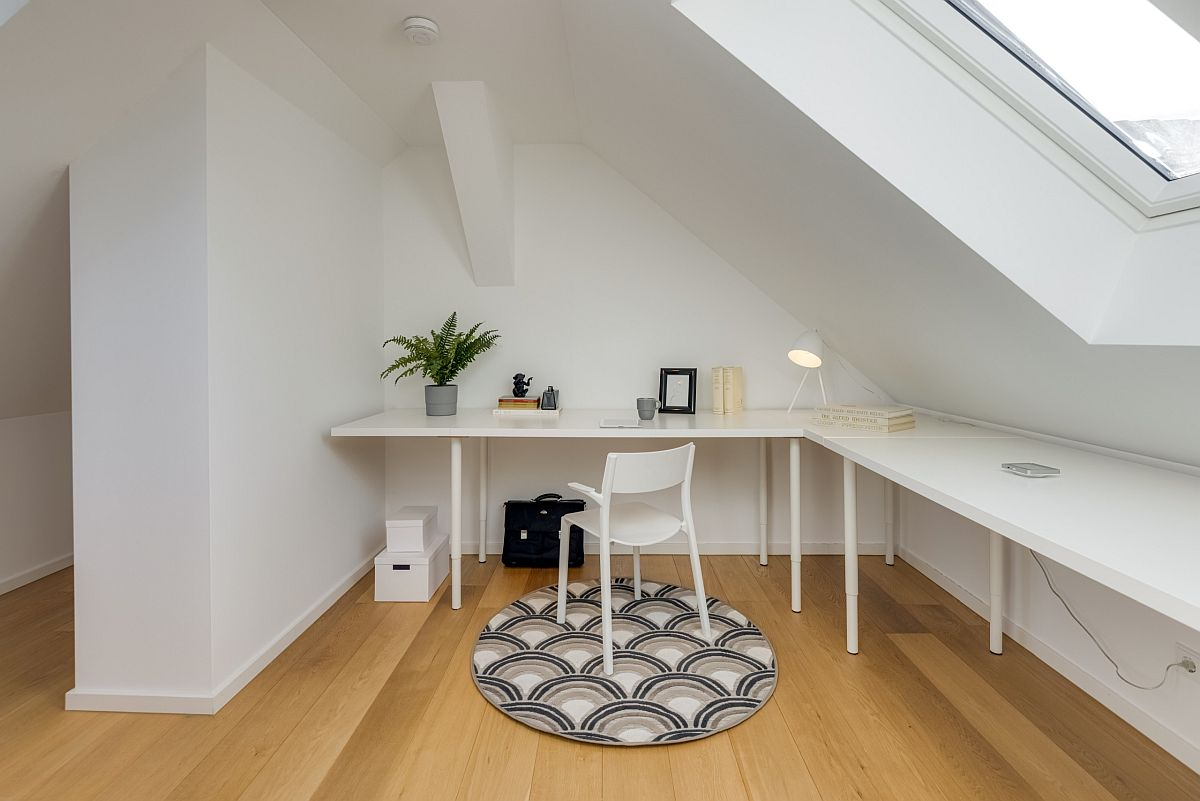Modern space-savvy home office in white with ample natural light