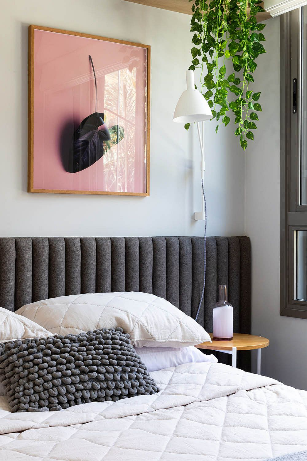 Natural-greenery-along-with-framed-botanicals-brings-freshness-to-the-bedroom-99787