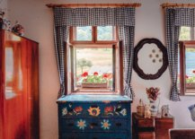Open windows with checkerd curtains