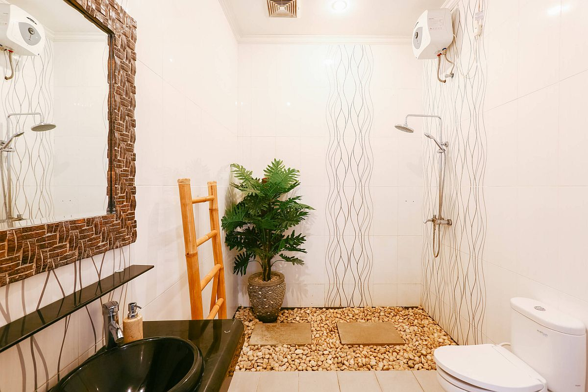 Pebbles-a-hint-of-greenery-and-natural-finishes-bring-tropical-style-to-the-neutral-bathroom-61843