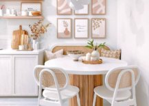 Picture-perfect-whie-and-wood-dining-room-with-a-round-dining-table-and-pastel-accents-13844-217x155