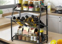 Rack full of bottles and dry herbs on top of brown kitchen counter