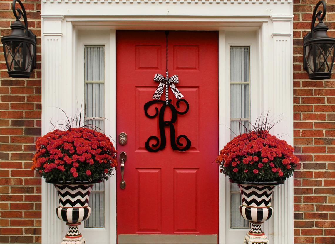 Red door with red flowers on the sides