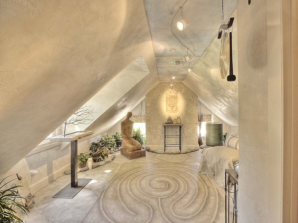 Sand garden, lighting and a beautiful backdrop help create this meditation room