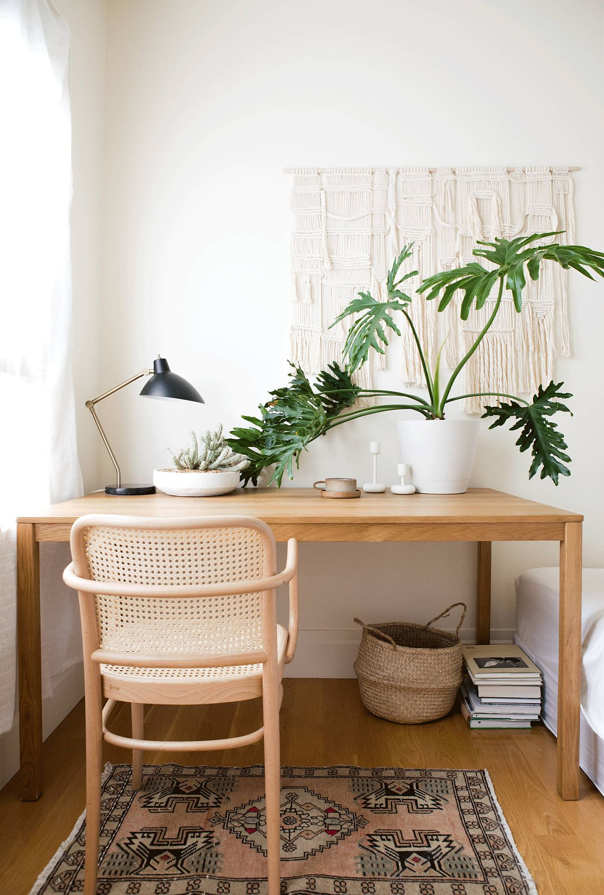 Scandinavian style home office in wood and white with a dash of green brought in by indoor plants