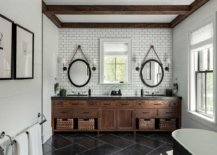 Sconce-lighting-plays-a-big-role-in-creating-a-symmetric-picture-perfect-look-in-this-bathroom-21181-217x155