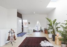 Skylight-and-triangular-window-bring-ample-natural-light-into-the-white-upper-level-of-the-new-extension-83570-217x155