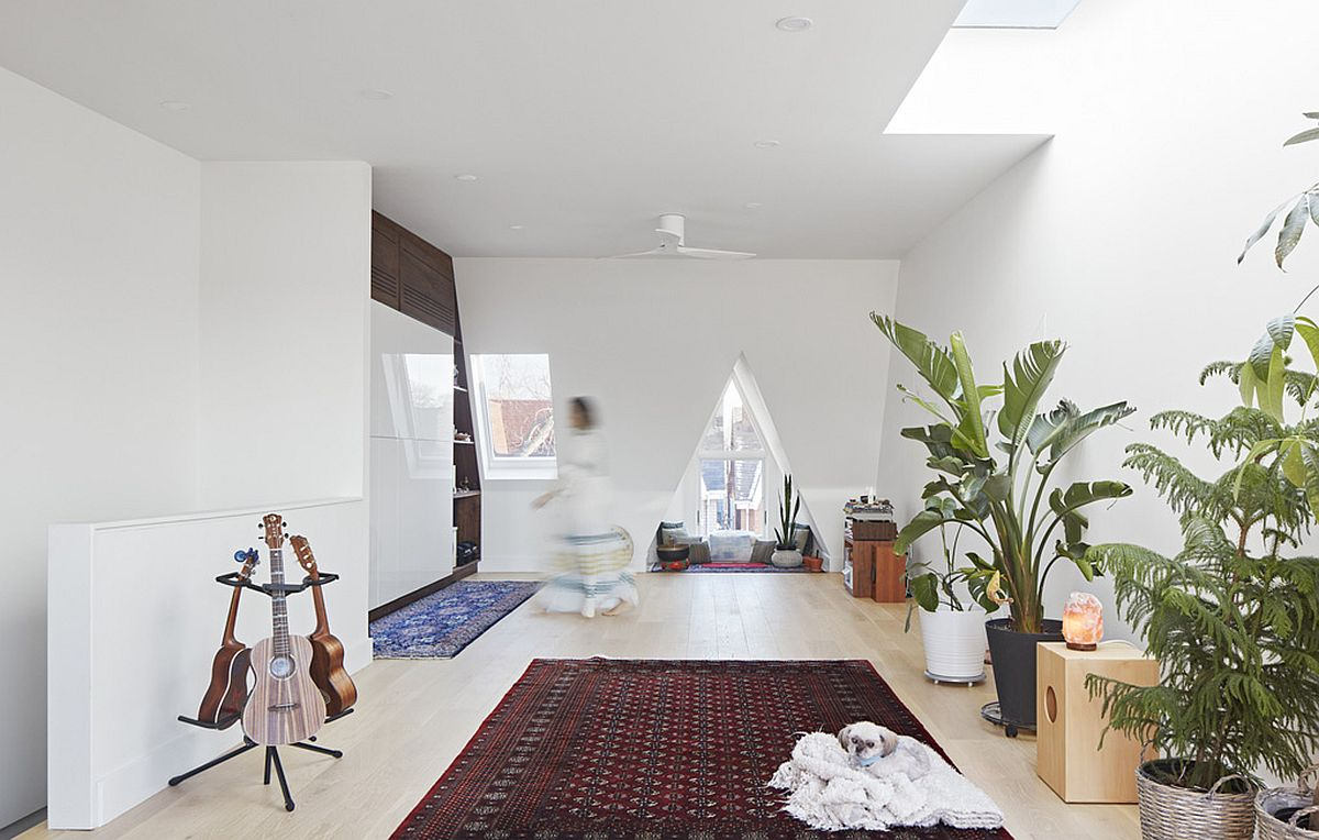 Skylight-and-triangular-window-bring-ample-natural-light-into-the-white-upper-level-of-the-new-extension-83570