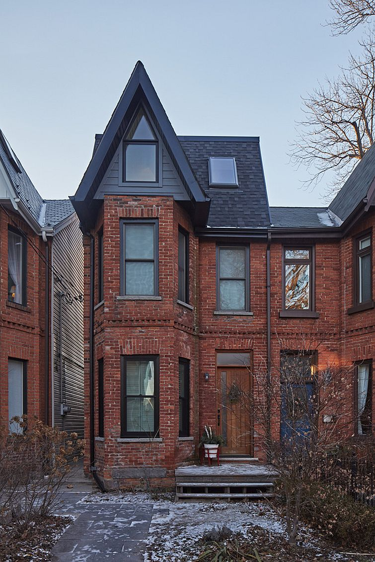 Street view of Victorian semi-detached home in Toronto with a modern rear extension