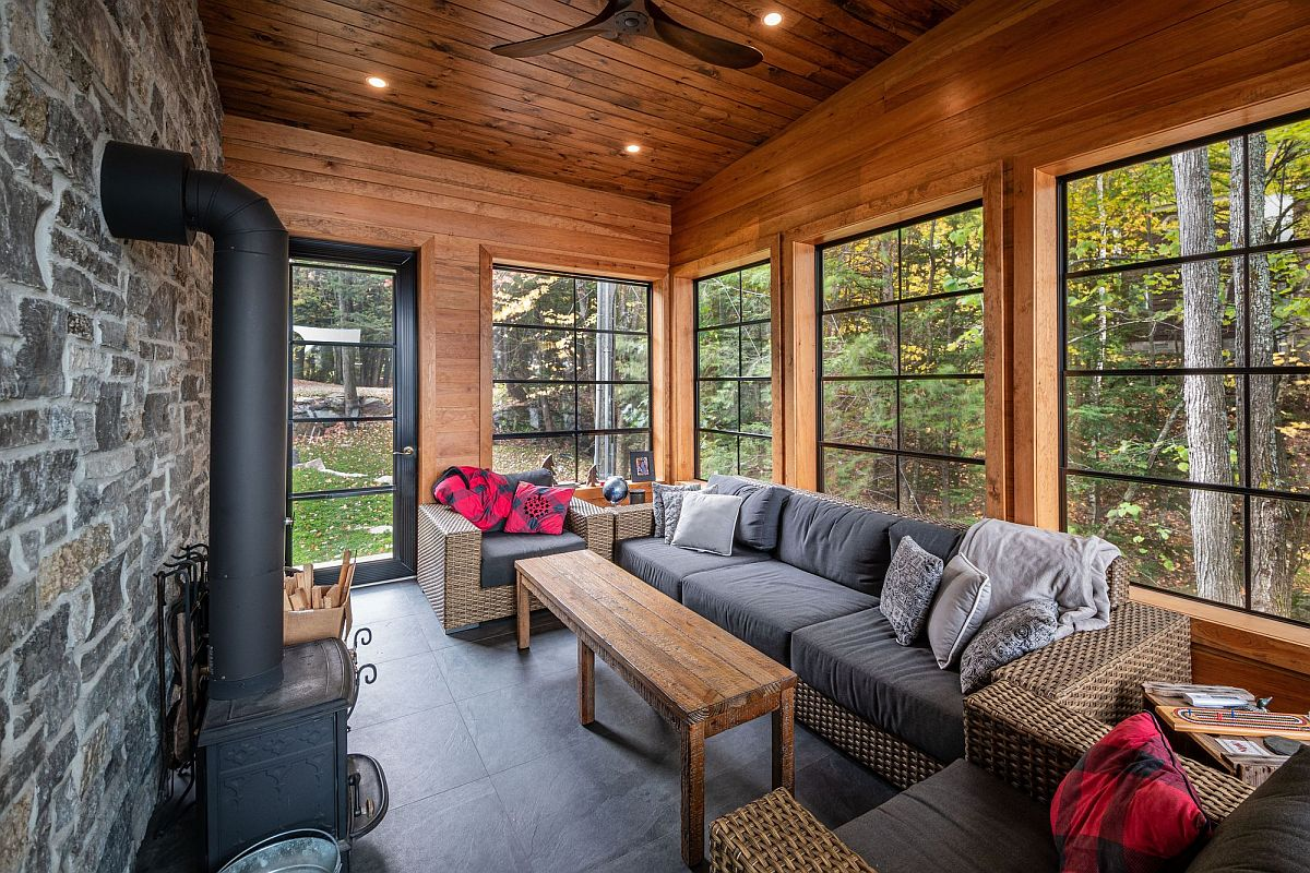 Sunroom of the home with a fireplace and comfortable seating