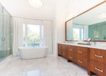 Sweeping-contemporary-bathroom-next-to-the-master-bedroom-with-wooden-vanity-and-marble-flooring-28678-217x155