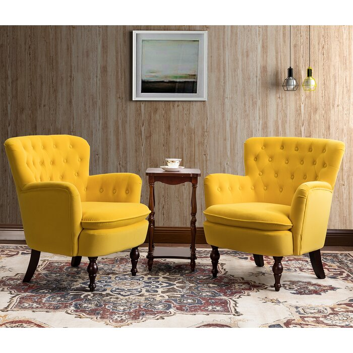 Two huge yellow chair with small coffee table in the middle