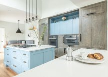 Uber-light-blue-cabinets-along-with-a-matching-kithen-island-usher-in-subtle-beach-style-77890-217x155