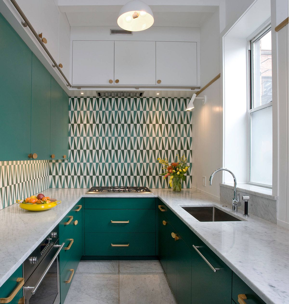 Using dark green cabinets in the small modern kitchen along with a snazzy backsplash