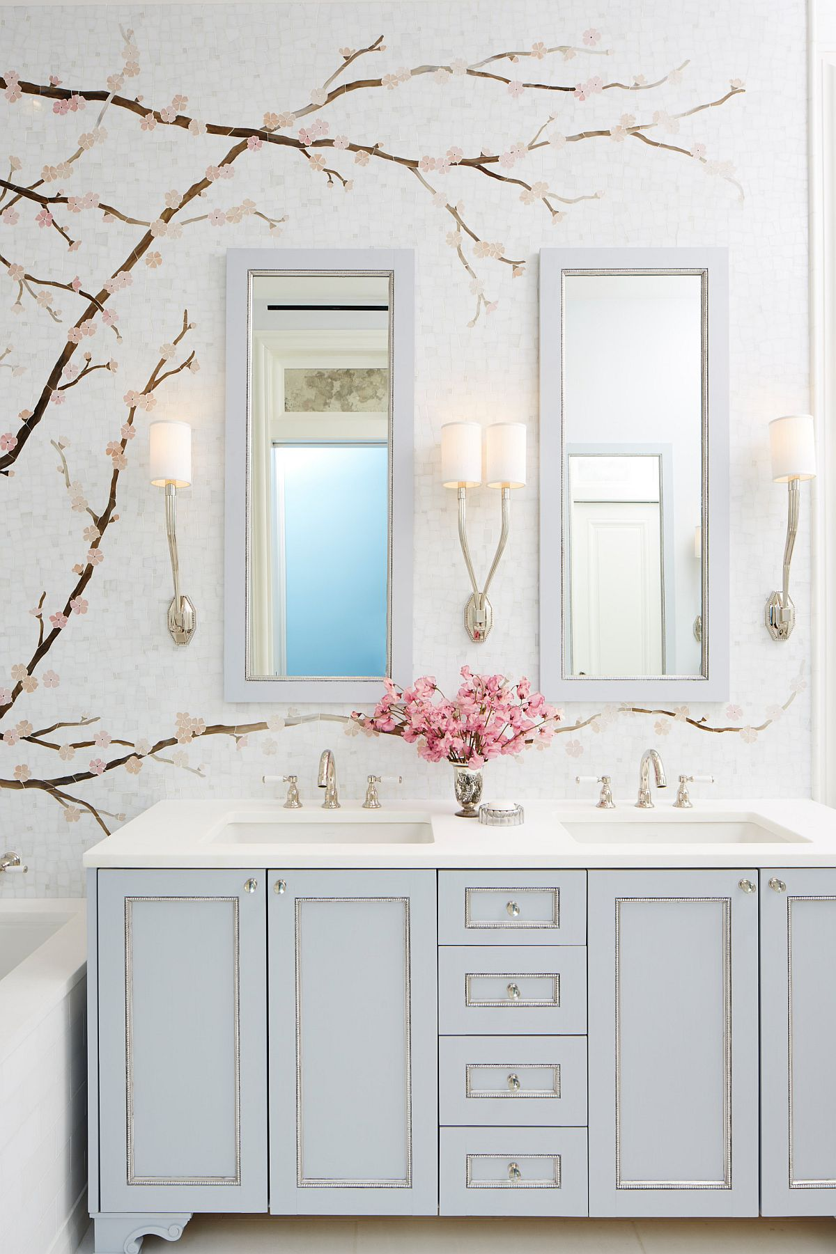 Vanity lighting in this exquisite contemporary bathroom plays into the overall whimsical narrative