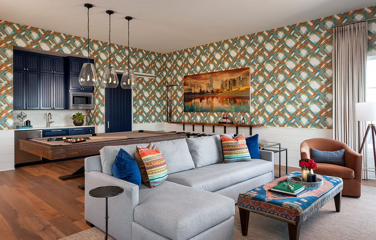 Wallpaper creates a colorful and pattern filled backdrop in this family and game room