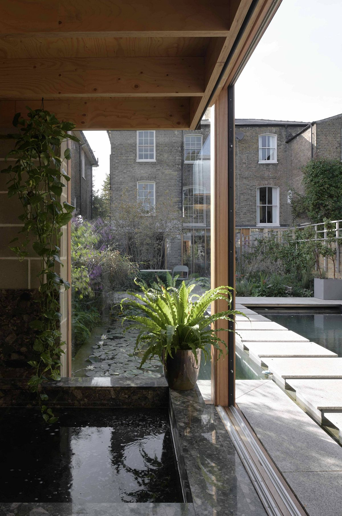 Water features and greenery become a natural part of the lovely garden room