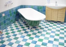 White and green tub on small blue, green and white square tiles