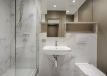 White bathroom with marble floor and walls