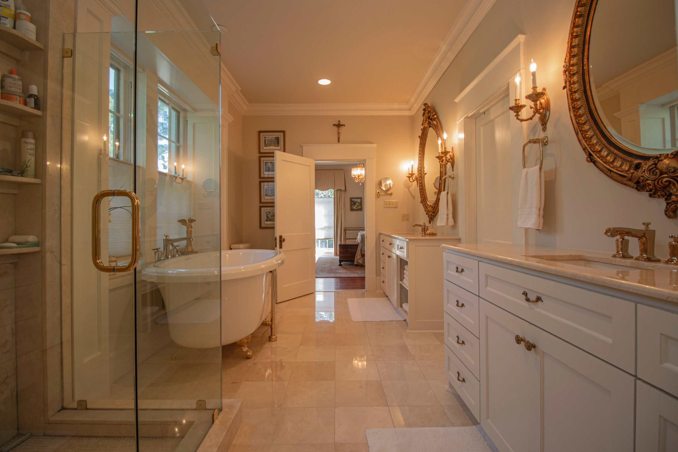 White bathroom with two big gold mirrors