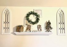 White floating mantel with green wreath and makeshift windows