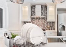 White plates on top of kitchen counter