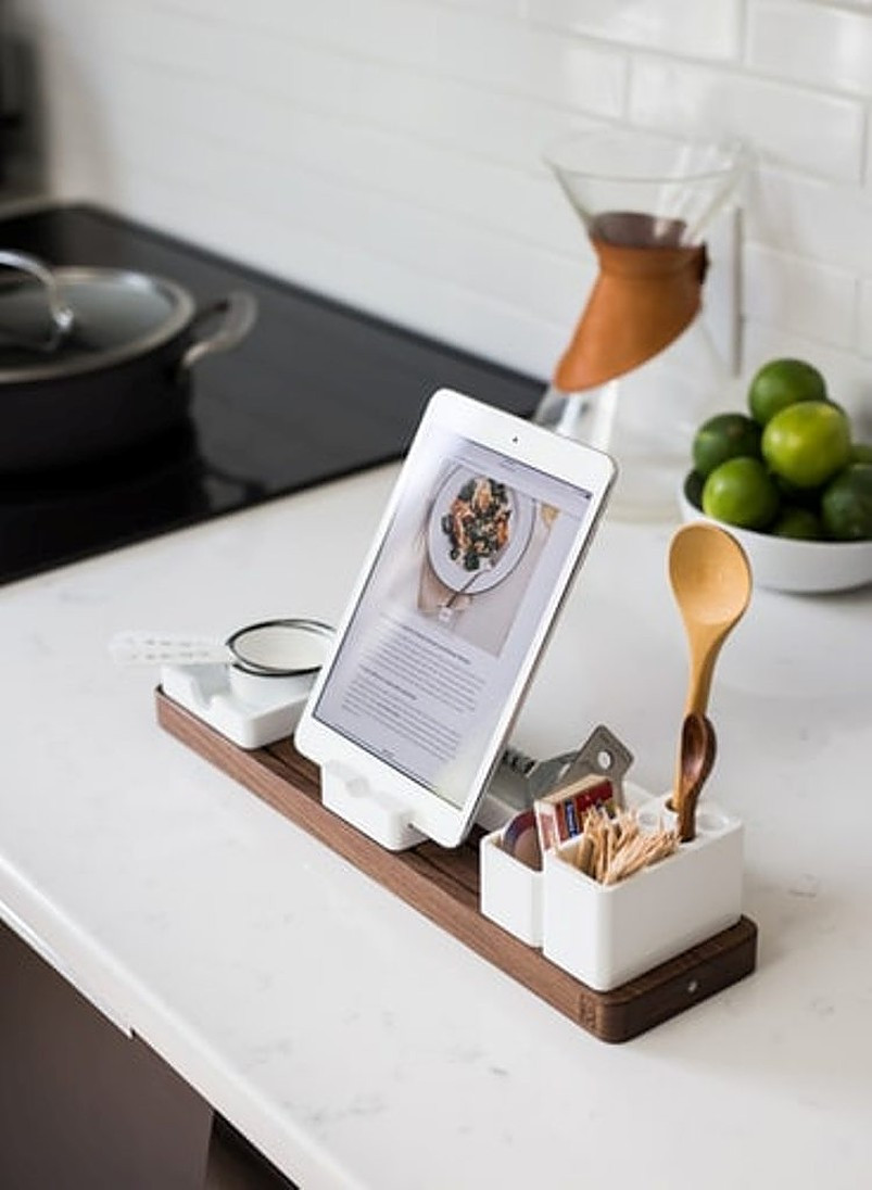 White tablet standing on top of white counter