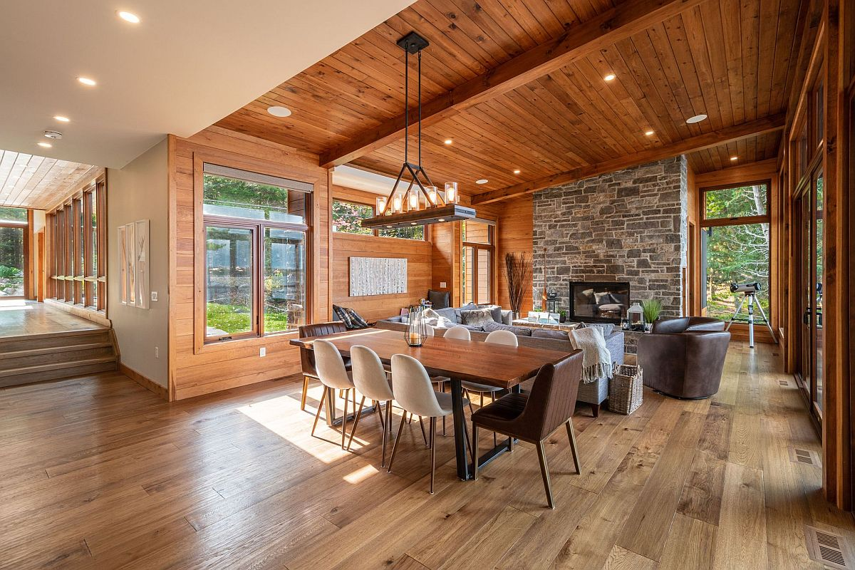 Wood and stone living area, dining room of the modern holiday home