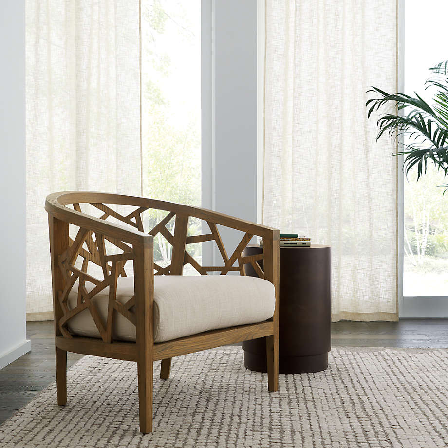 Wood armchair with geometric design and fabric cushion