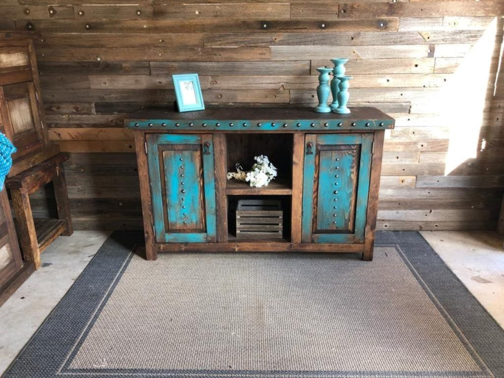 Wood cabinet with patches of blue paint