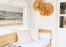 Wooden chair and woven beach hats