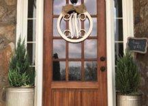 Wooden door with glass panels and monogram door hanger