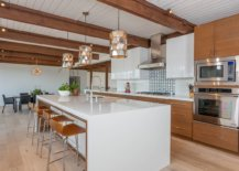 Wooden-kitchen-cabinets-coupled-with-white-island-in-the-spacious-midcentury-kitchen-49247-217x155