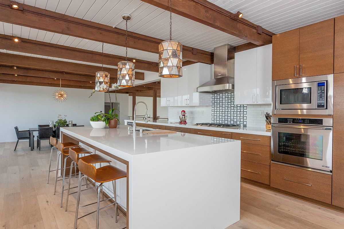 Wooden-kitchen-cabinets-coupled-with-white-island-in-the-spacious-midcentury-kitchen-49247