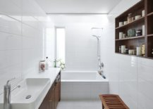 Wooden-vanity-with-white-countertops-and-white-walls-all-around-in-the-bathroom-96701-217x155