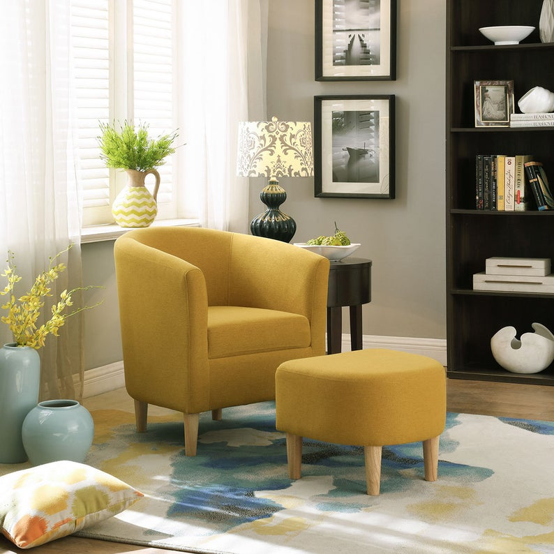 Yellow chair with yellow leg rest in stylish living room
