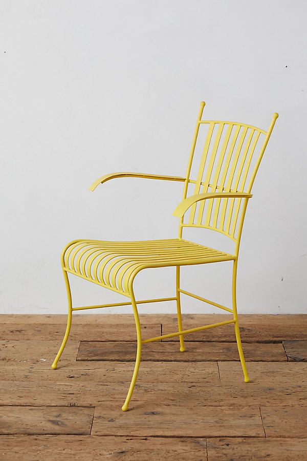 Yellow steel armchair on wood floor