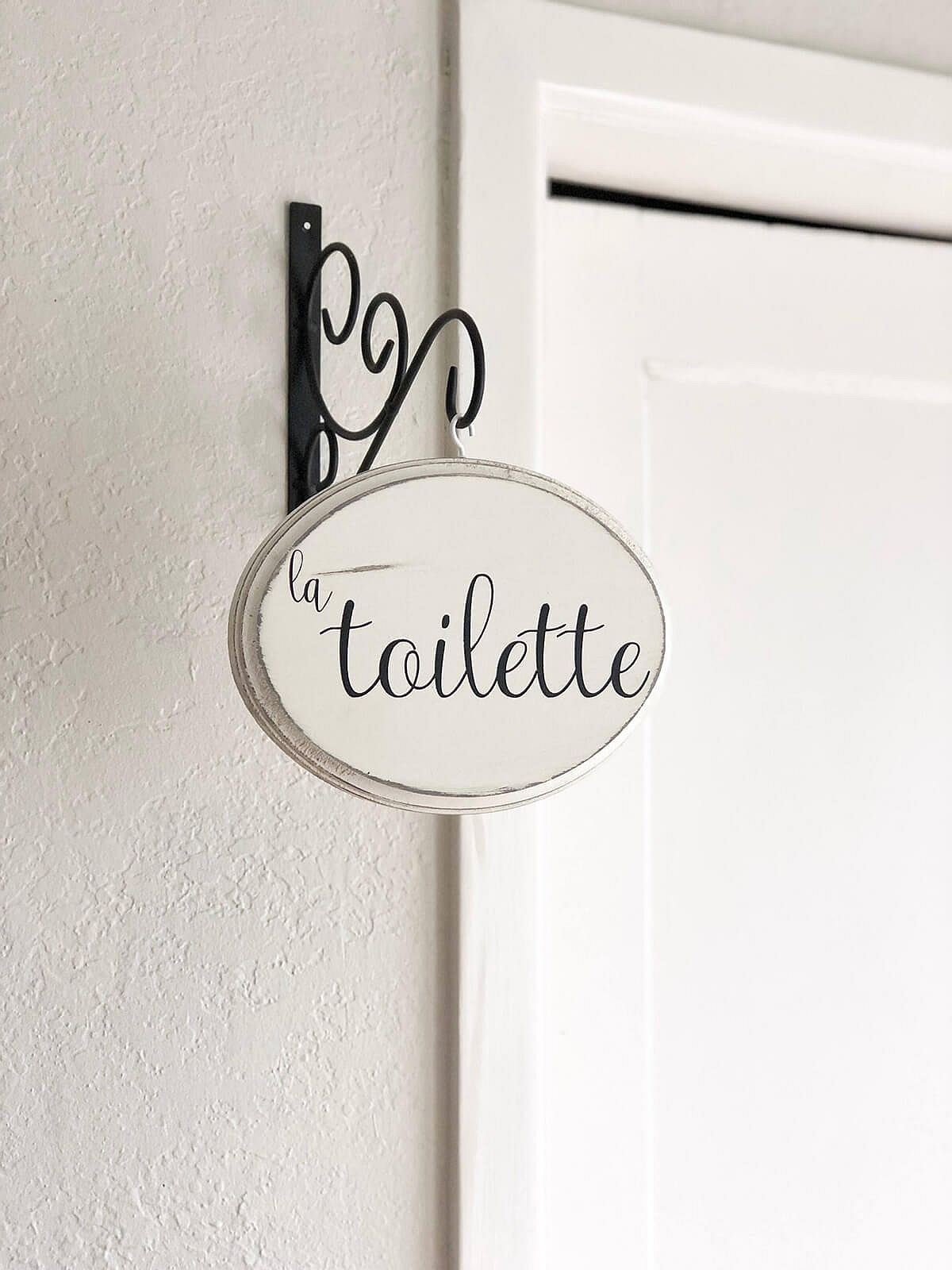 Add a bit of French panache to the bathroom with a custom sign!