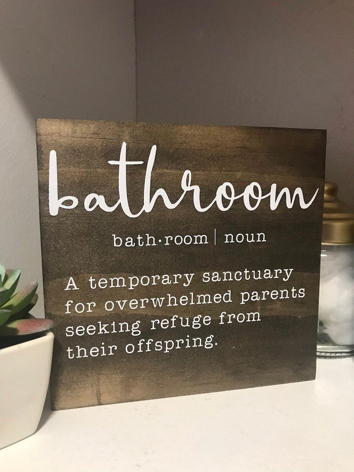 Bathroom sign that redefines the very idea of a modern bathroom!