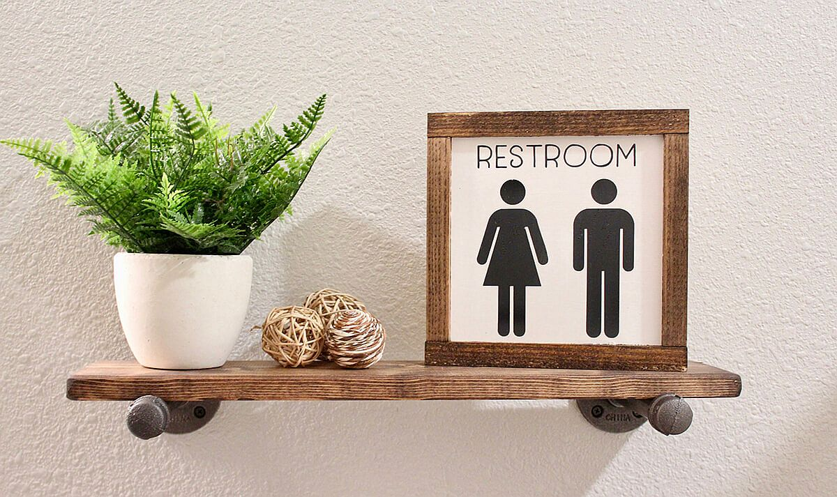 Beautiful and small restroom sign can be placed on the small shelf in the bathroom pretty much anywhere