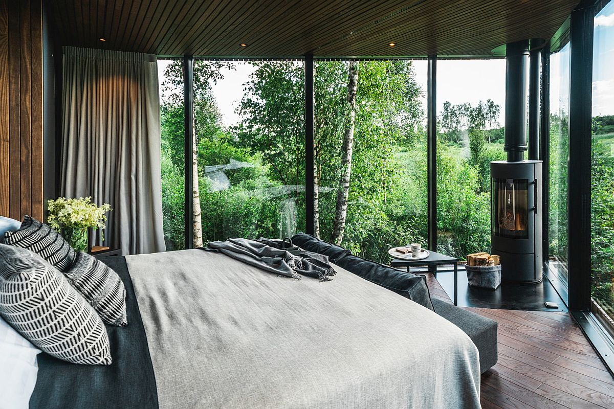Bedroom-of-the-cabin-with-king-size-bed-and-a-cozy-fireplace-in-the-corner-79669
