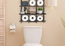 Big square storage divided into nine small squares full of essentials above toilet seat