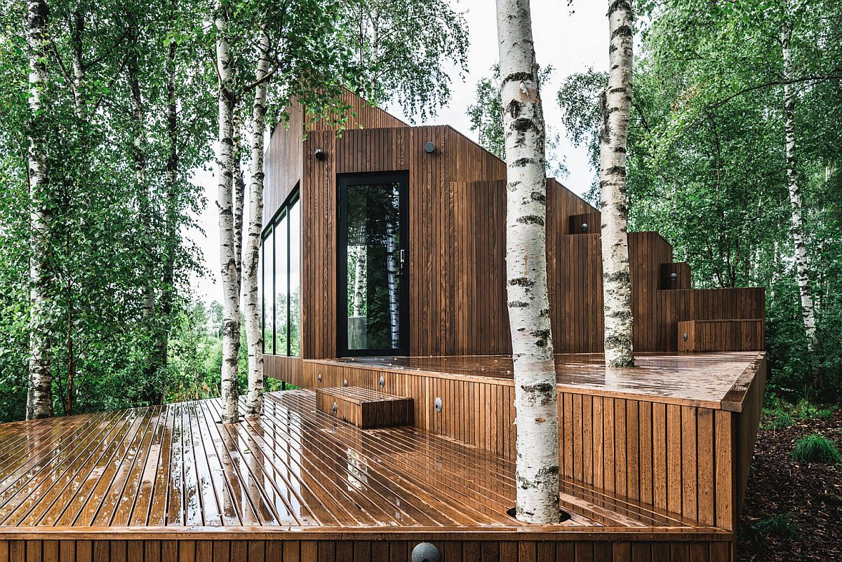 Birch trees around the cabin are left intact as they grow into the wooden deck