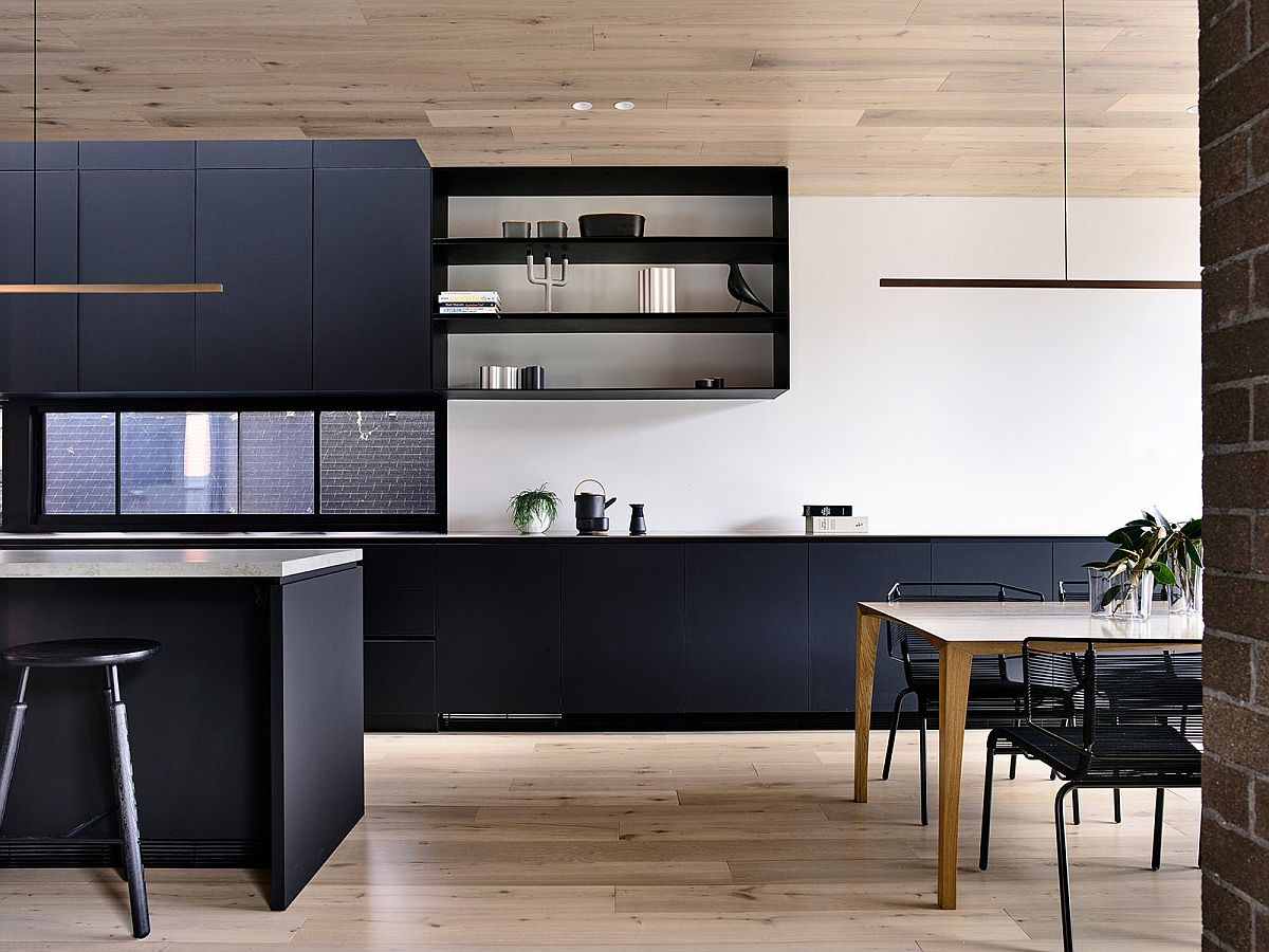 Bluish-gray kitchen island and cabinets bring contemporary panache to the new home interior