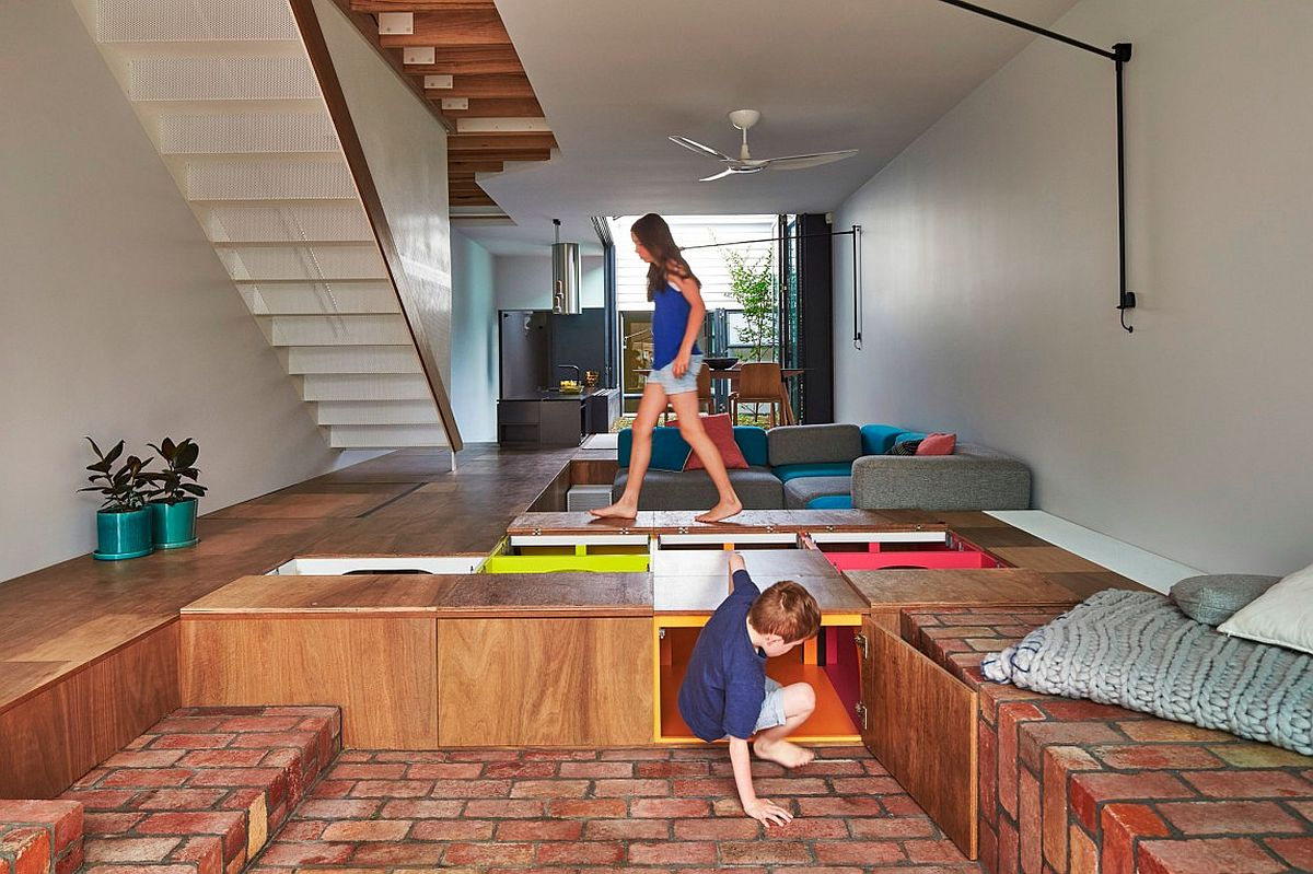 Boxes built into the floor offer amazing storage space in this modern home