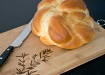 Bread and knife on top of cutting board