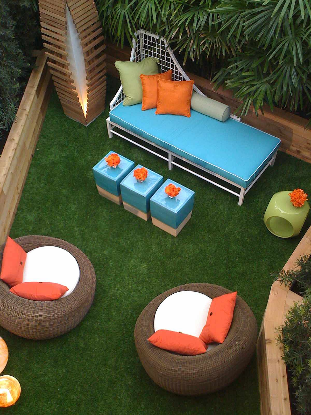Brilliant blue seats along with curated orange accents for the small outdoor patio