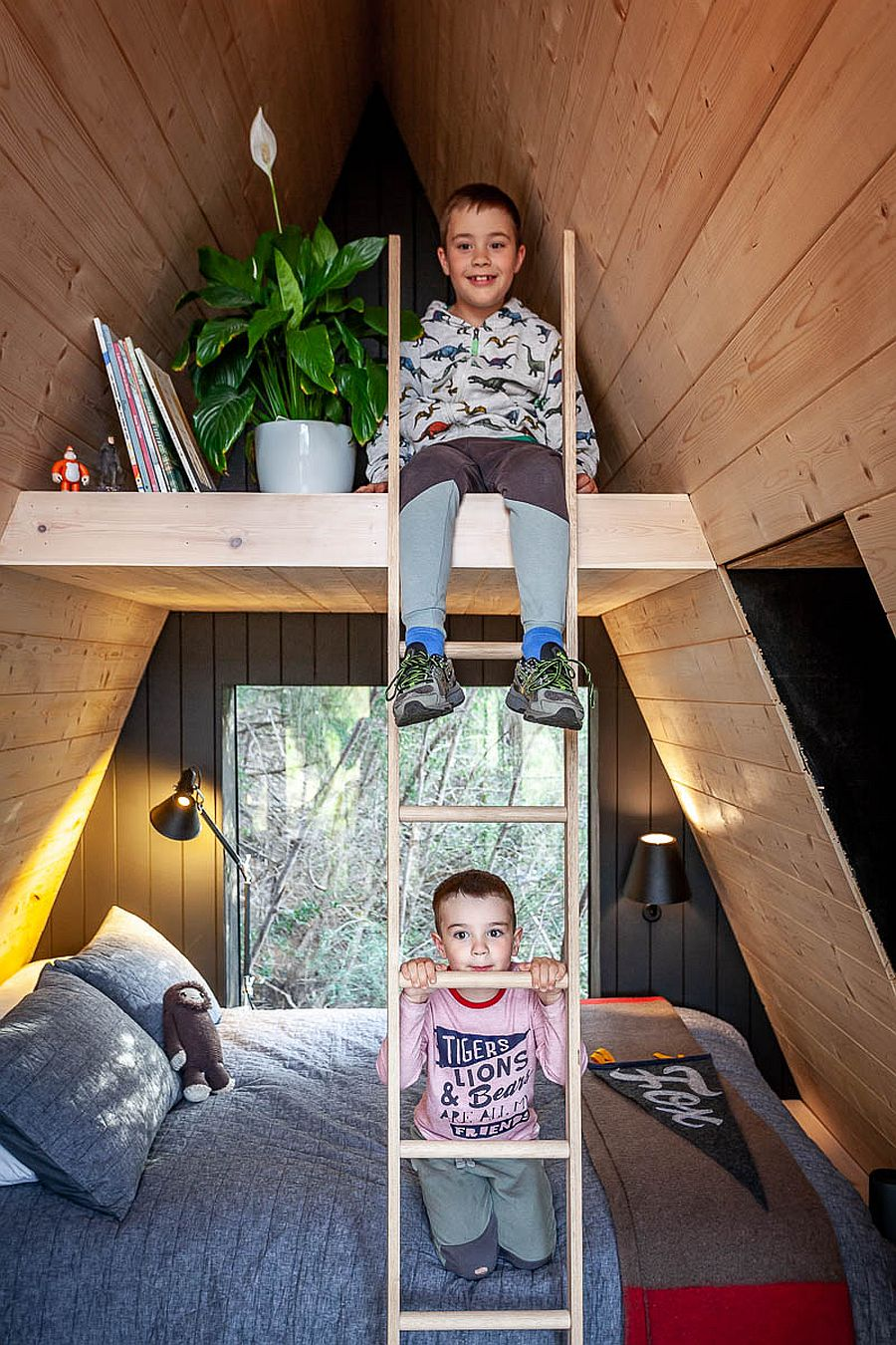 Bunk beds inside the A-frame treehouse for the two boys