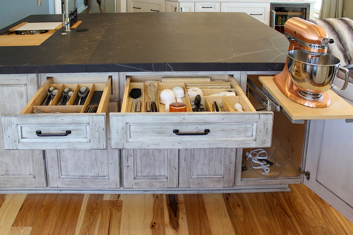 Clever custom storage solutions for the rustic kitchen in gray and white with wooden cabinets and stone countertops