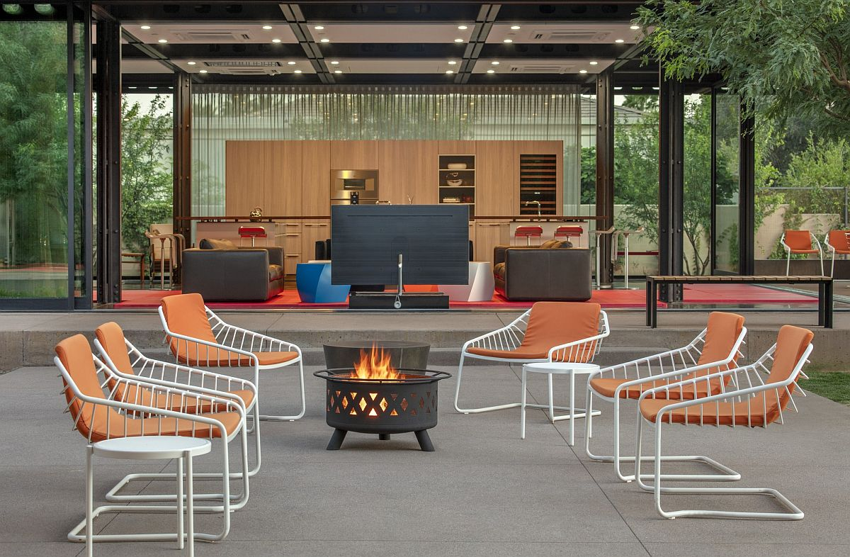 Colorful chairs coupled with a fire pit for a cozy outdoor lounge